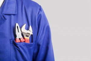 technician-shoulder-and-shirt-pocket-with-tools-in-it